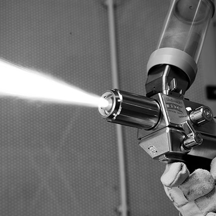Flame spraying guns for corrosion protection